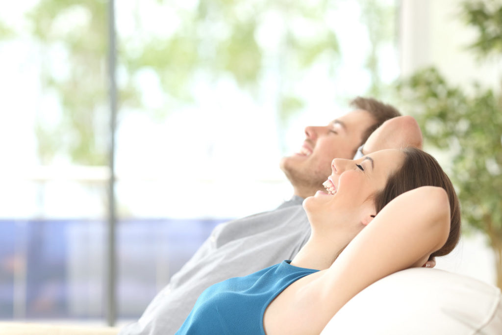 a relaxing couple after using services from our mold remediation company in Redondo Beach